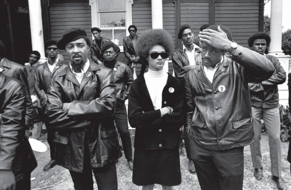 Kathleen-Cleaver-and-Black-Panther-co-founder-Bobby-Seale-right-at-a-Free-Huey-rally-in-Oakland-California-in-the-summer-of-1968.-Photograph-Howard-Bingham